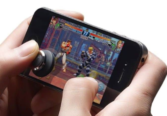 The-Brick-Joystick-Attaches-To-Your-Smartphones-Screen-Allowing-You-To-Play-Smartphone-Games-Like-A-Pro
